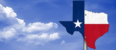 texas state flag against blue sky background