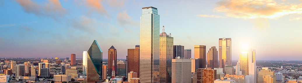 view of a dallas skyline at sunrise