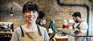 Small Business Owner Woman with Chocolate Cake